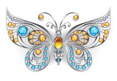 Silver butterfly with amber gems. Silver, jewelry butterfly, decorated with amber and larimar on a white background. Design of jewelry. Larimar and Amber Stock Photo
