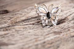 Silver butterfly on wood Stock Photography