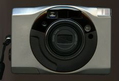 Silver camera. A silver camera isolated on black Royalty Free Stock Image