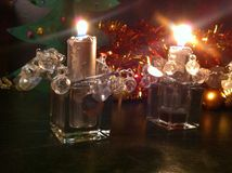 Silver candles in candle holders. Christmas toys, festive background,night stock images
