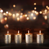 Silver candles in front of a festive background Royalty Free Stock Image