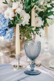 Silver candlestick as element of festive table wedding decorations. Stock Photography
