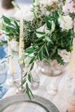 Silver candlestick as element of festive table wedding decorations. Royalty Free Stock Photo