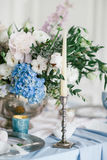 Silver candlestick as element of festive table wedding decorations. Stock Images