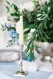 Silver candlestick as element of festive table wedding decorations. Royalty Free Stock Images