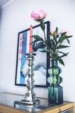 Silver candlestick & pink peonies royalty free stock images