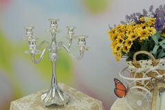 Silver candlesticks on the table Royalty Free Stock Image