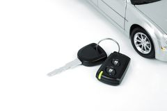 Silver car and car key. Silver car and a car key Royalty Free Stock Photo