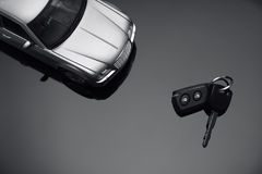 Silver car and car key. Silver car and a car key on black Stock Photo