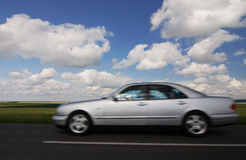 Silver car and cloudy sky Royalty Free Stock Photography