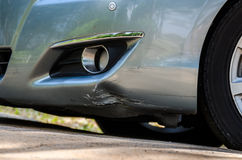 Silver Car damage. At front skirt royalty free stock photography