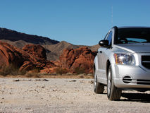 Silver car in the desert Stock Photo