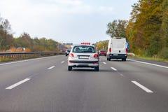 Silver car drives on a german motorway. A silver car drives on a german motorway stock photography