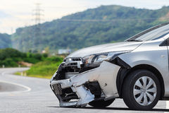 Silver car get damaged by crash accident on the road. Car repair. Front of silver car get damaged by crash accident on the road. Car repair or car insurance Stock Photo