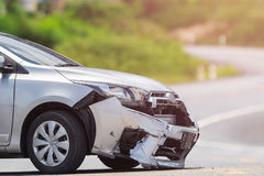 Silver car get damaged by crash accident on the road. Car repair. Front of silver car get damaged by crash accident on the road. Car repair or car insurance Royalty Free Stock Photo