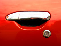Silver car handle on red background. With lock Royalty Free Stock Photography