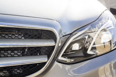 Silver Car light. White Car headlight close-up stock image