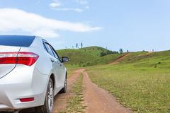 Silver car parking at the grass hill in Ranong province Stock Photography