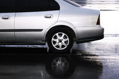 Silver car on parking in the rain Royalty Free Stock Image