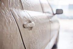 Silver car in shampoo Stock Photos