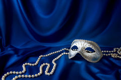 Silver carnival mask and pearl Stock Photos