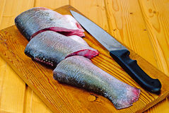 silver carp steak and  knife  on wooden  board Stock Photography