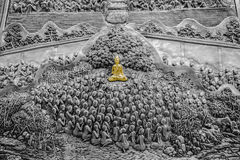 Silver carving art of Buddha and Disciple monk. On temple wall of Wat Srisupan Chiangmai Thailand Stock Photos