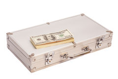Silver case with dollars on white Stock Images