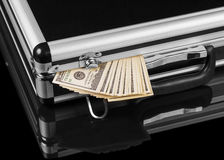 Silver case with money. On black background Stock Images