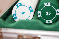 Silver case with poker chips on a table. Photo of silver case with poker chips on a table royalty free stock images