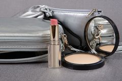 Silver cases,  lipstick and powder Stock Images