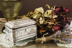Silver Casket, jewelry/trinket box with dry roses and lavender Royalty Free Stock Image