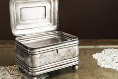 Silver Casket, jewelry/trinket box on retro table Royalty Free Stock Image