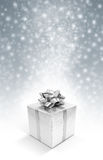 Silver celebration gift boxe on snow background Stock Photo