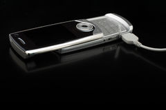 Silver cell phone Stock Image