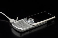 Silver cell phone Stock Images