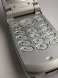 Silver Cellular Flip Phone. Silver cell phone, flip hand phone close up. Great for modern communications, technology, business, telecommunications and more Royalty Free Stock Photos