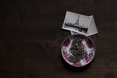 Silver Chain Accessory on White and Purple Ceramic Plate Near Grayscale Eiffel Tower Picture Stock Photography