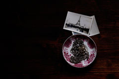 Silver Chain Accessory on White and Purple Ceramic Plate Near Grayscale Eiffel Tower Picture Stock Images