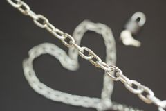 Silver chain on black background, concept strong love stock photography