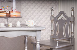 Silver Chair at Dining Table Set for Tea with Cake Royalty Free Stock Photo