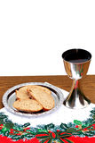 Silver chalice with bread on Christmas background