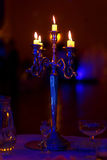 Silver chandelier and burning candles on decorated wedding table. Stock Images