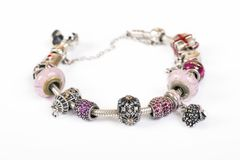 Silver charm bracelet. With pink beads isolated on white background Stock Image