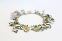 Silver charm bracelet Stock Photography