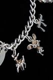 Silver charms on chain. Stock Image
