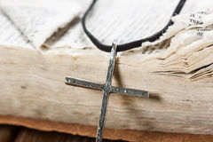 Silver christian cross on bible Stock Images
