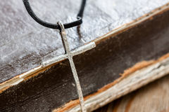 Silver christian cross on bible Royalty Free Stock Images