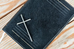 Silver christian cross on bible Stock Photo