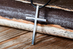 Silver Christian cross on bible Stock Image